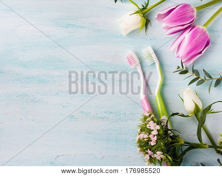 Two Pastel Toothbrushes With Flowers Herbs. Spring Colors