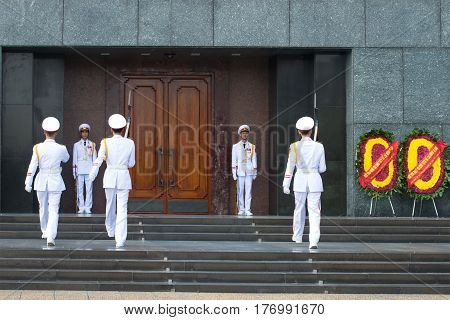 HANOI, VIETNAM - JANUARY 10, 2016: Сhange the soldiers of the honor guard at the entrance to the Ho Chi Minh mausoleum