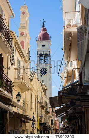 Narrow streets of Kerkyra Corfu island Greece. Bell tower of the Saint Spyridon Church