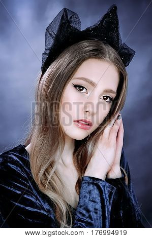 Portrait of beautiful majestic royal person of queen fantasy character with luxury precious black crown wearing blue dress