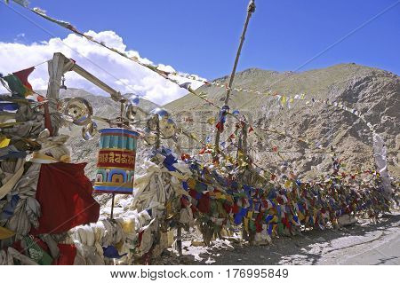 Colorful Buddhist Prayer Flags on a High Mountain Pass in the High-Altitude Mountain Desert in the Himalayas, Spiti Valley, Northern India.