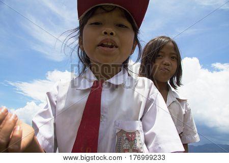 LAKE TOBA SUMATRA INDONESIA - 13 MARCH 2012 : Children in school uniform