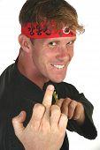 Smiling thirty something man in taekwon do uniform making rude hand gesture. poster