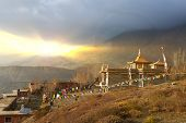 The photograph was taken during a hike around the Annapurna mountains in the Himalayas of Nepal. Buddhist monastery on the border of Nepal and the Kingdom of Mustang. poster