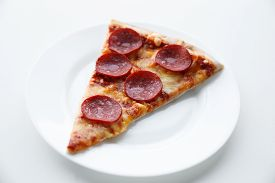 Pepperoni pizza. Hot homemade food. Slice of fresh italian classic salami pizza. Popular topping with cheese. Baked meal.