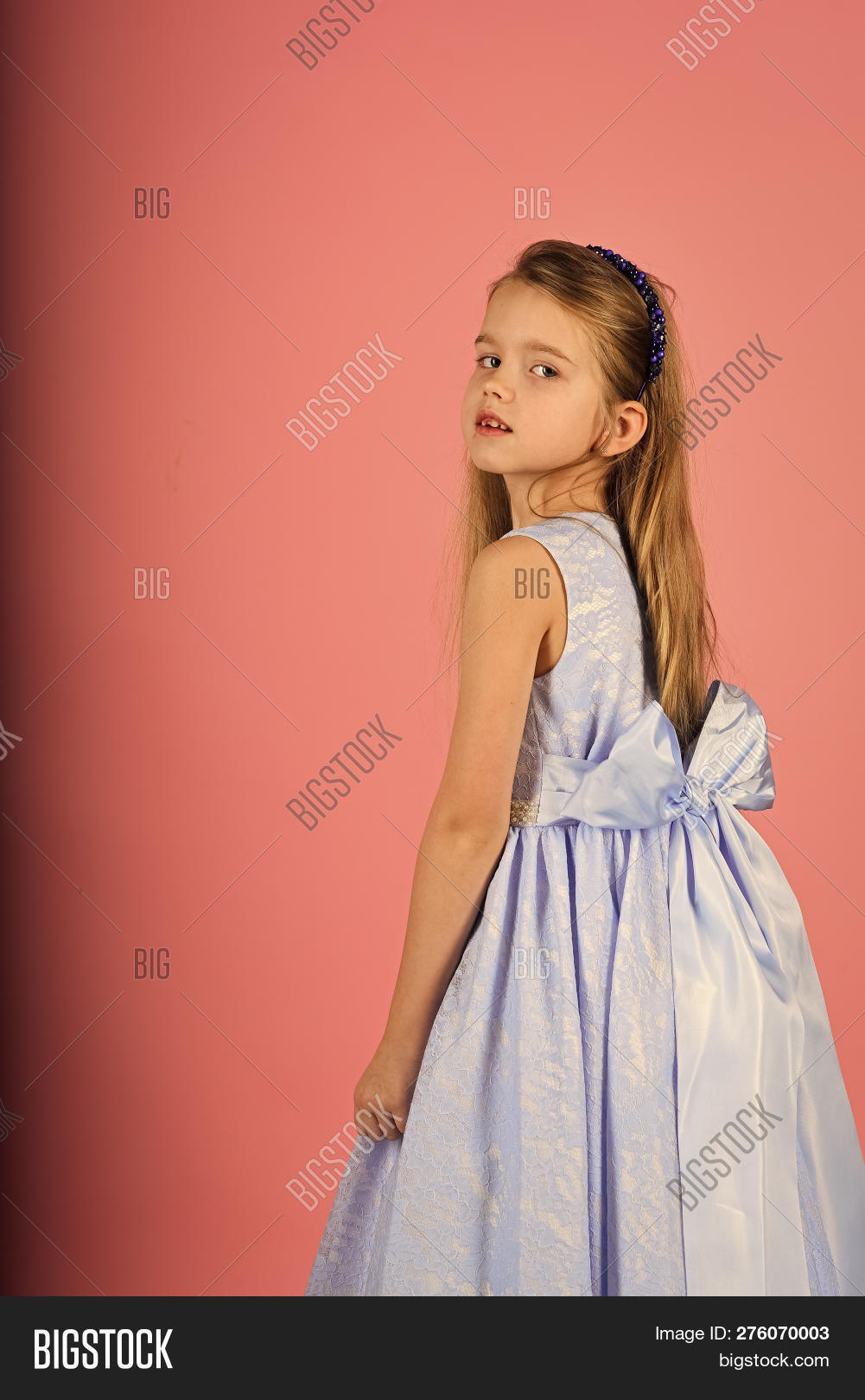 6bb4786455aa Little girl in fashionable dress, prom. Fashion model on pink background,  beauty. Fashion and beauty, little princess. Look, hairdresser, makeup.