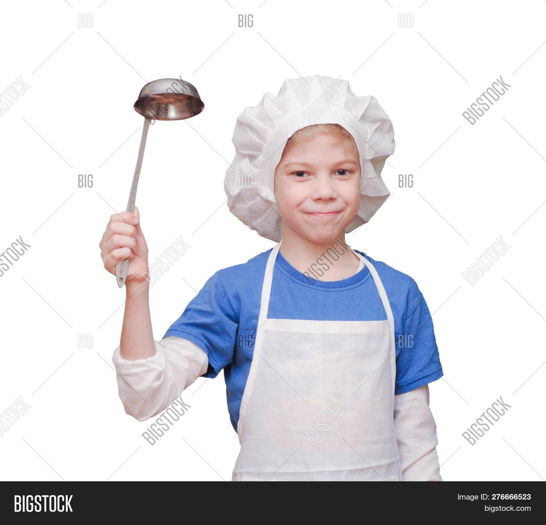 Cheerful handsome teen boy wearing chef uniform. Portrait of a happy cute  male child cook 3a62febf1710