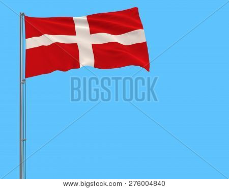 Flag Of Sovereign Military Order Of Malta On The Flagpole Fluttering In The Wind On A Pure Blue Back