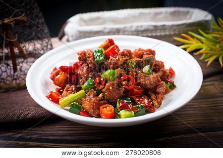 Spicy Sichuan Chicken In A White Dish