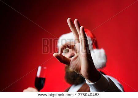 Santa Shows Sign Ok At Camera. Bearded Man Shows Sign Ok At Camera. Smiling Man In Santa Costume. Ch