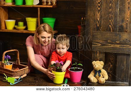 Ecology Concept. Little Son Help Mother Planting Flower To New Pot, Ecology. Ecology And Environment