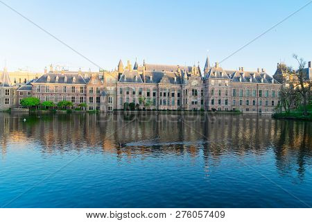Facade Of Binnenhof - Dutch Parliament With Reflections In Hofvijver Pond, The Hague, Holland