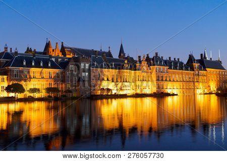 View Of Binnenhof - Dutch Parliament At Night Over Hofvijver Pond Illuminated At Night, Hague Hollan