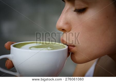 Perfect Morning With Green Coffee. Matcha Latte Tea Ceremony Of Girl. Woman Drink Japanese Tea From