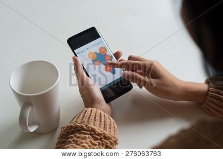 Close-up Of Unrecognizable Lady Analyzing Results Of Survey In Africa. Busy Woman Sitting At Table A