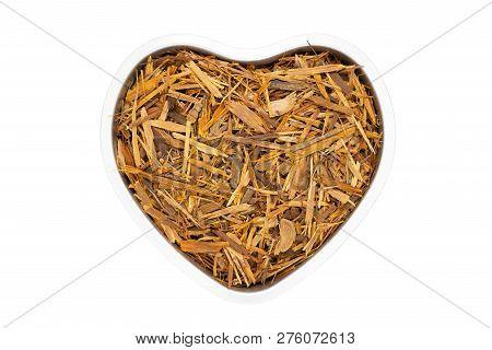 Catuaba bark tea in heart shape, isolated. Natural herbal tea from powdered Catuaba tree bark. Brazilian aphrodisiac used as antidepressant, antioxidant and nervous system stimulator. poster