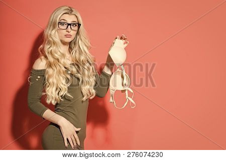 Woman With Long Blonde Hair Hold Bra. Girl Student In Sexy Fashionable Dress And Glasses. Beauty And