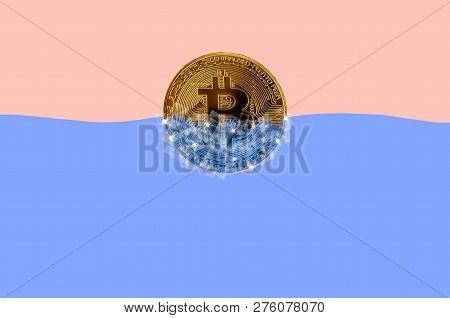 Frozen Golden Bitcoin In Blocks Of Ice In Blue Water