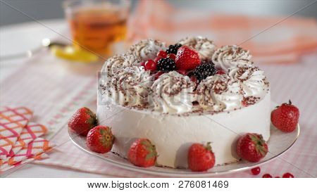 Cake With Whipped Cream And Strawberries On A Stand, Close-up. Scene. Sliced No Bake Strawberry Chee