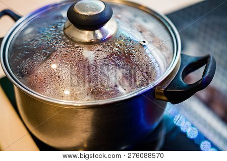 Metal Pan With Misted Lid. Water Droplets On The Dishes During Cooking On The Electric Stove. Close