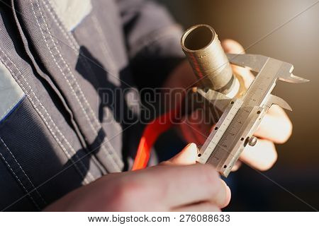 Plumber measures the diameter of the pipe with a caliper tap for plumbing poster