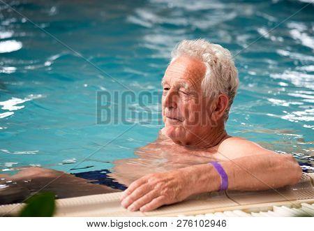 Elderly Man In Pool