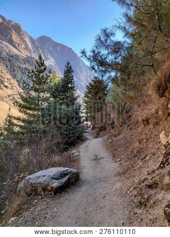 Narrow Trail In The Mountains Of Nepal. Trekking Trail Of Manaslu Conservation Area In Nepal.