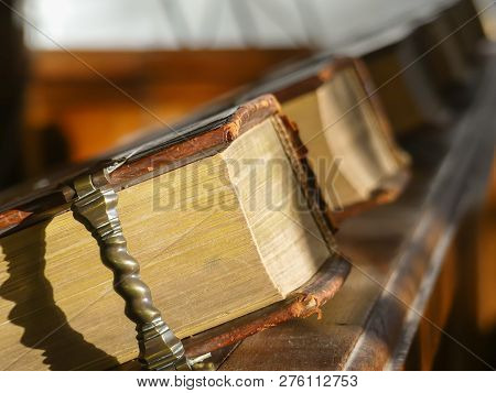 Ancient Leather Bound Hymn Books Inside Naturaully Lit Dutch Church In Zeeland
