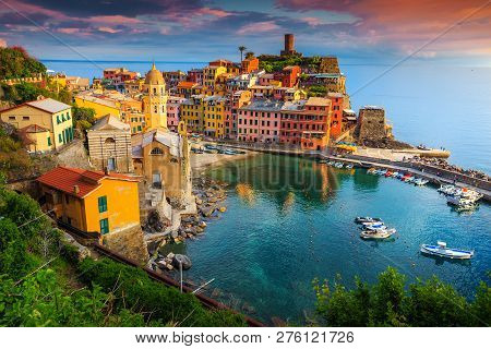 Fantastic Panorama Of Vernazza, Amazing Colorful Medieval Buildings And Fishing Boats In Harbor At S