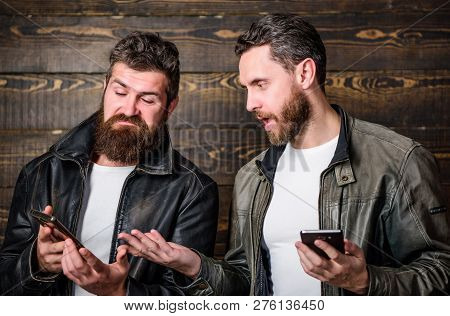 Men With Smartphones Surfing Internet. Mobile Internet. Business Application. Men Brutal Bearded Hip