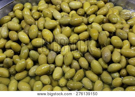 Green Freshly Picked Olives In Brine For Sale At The Italian Food Stand In South Italy