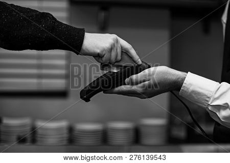 Customer Hand Paying With Credit Card. Credit Card Payment And Electronic Bank Concept. Cashier Hold