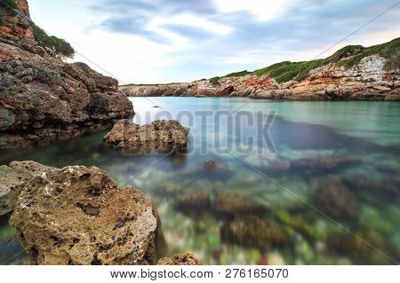 Lonely, rocky bay with transparent water on the island of Mallorca. Cala Petita.