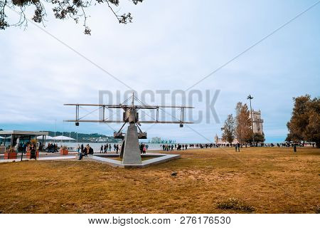 Lisbon, Portugal - August 13, 2018: Tourists Are Near The Statue Of Gago Coutinho Sacadura Cabral Pl