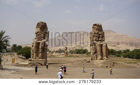 Luxor, Egypt -september 30, 2018: Colossi Of Memnon Are Two Gigantic Stone Statues Of Amenhotep Iii