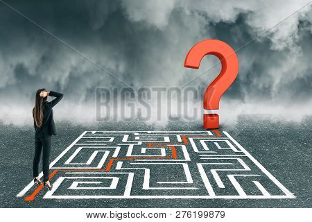 Thoughtful Young Businesswoman With Maze And Question Mark On Dull Sky Background. Challenge And Con