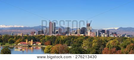 City Skyline Of Denver Colorado Downtown With Snowy Rocky Mountains And The City Park Lake. Large Pa