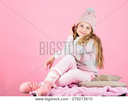 Kid Girl Wear Knitted Warm Hat Relaxing Pink Background. Winter Fashion Warm Clothes Concept. Child
