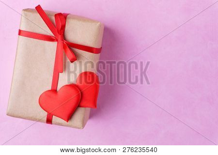 valentines day celebration, greeting card mockup, surprise for beloved. festive background with hearts and decorated gift box, copy space for text design poster