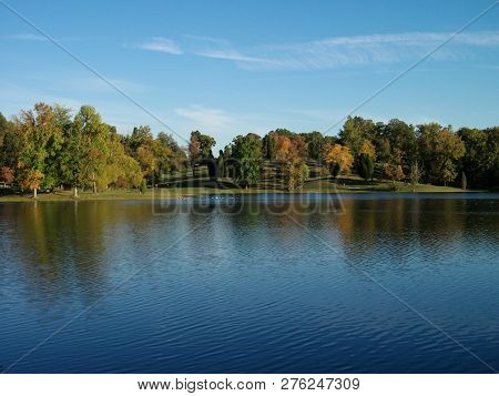 The Cool, Clear Water Of The Lake At Vastwood Park Reflects The Trees And Skies On An Early Autumn A