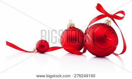 Three Red Christmas Decoration Bauble With Ribbon Bow Isolated On White Background