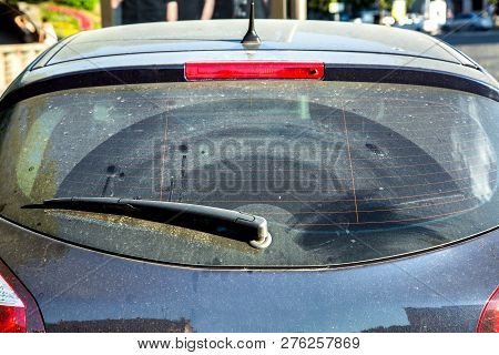 Dirty Car Rear Window, Car Wagon Covered With Dust Outside In Sunny, Close-up Rear Window With Car W