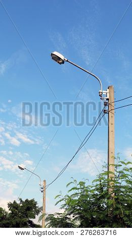 High Voltage Electricity Poles In The Forest, Electricity Pylons In Countryside, Old Power Poles In