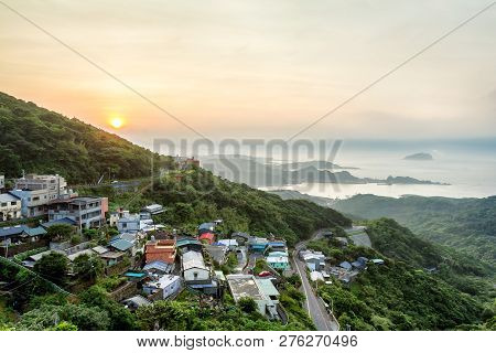A Sunset View Of An Old Street Town In Jiufen, Taiwan. This Place Is On A Hillside. There Are Old Bu