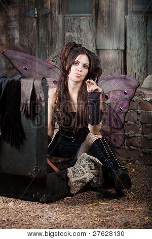 Tough fairy smokes cigarette in a rustic location poster
