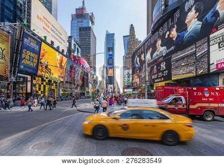 New York, Usa - May 22, 2018: People And Traffic At Times Square In New York City. It Is A Major Com