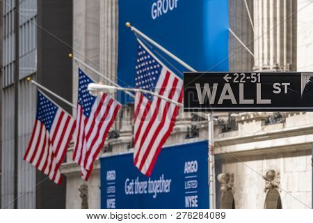 New York, Usa - May 8, 2018: Wall Street Sign Near New York Stock Exchange With Flags Of The United