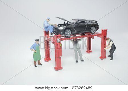 A Mini Figure Car Service Technician Checking