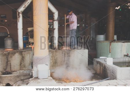 Worker At Mezcal Factory In Oaxaca Mexico