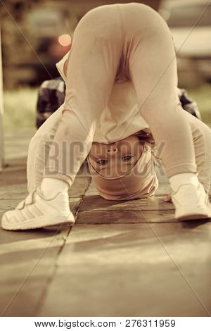 Kid Girl Stand On Head On Sunny Day Outdoor. Sport, Yoga, Pilates For Child. Activity, Energy Concep